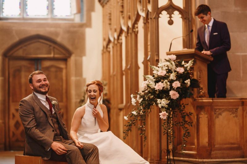 bride and groom laughing by Adam Johnson