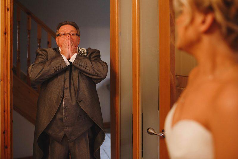 dad seeing daughter in wedding dress by Adam Johnson