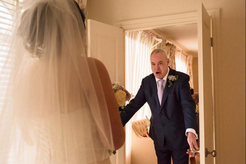 dad seeing daughter in wedding dress by Neil Redfern