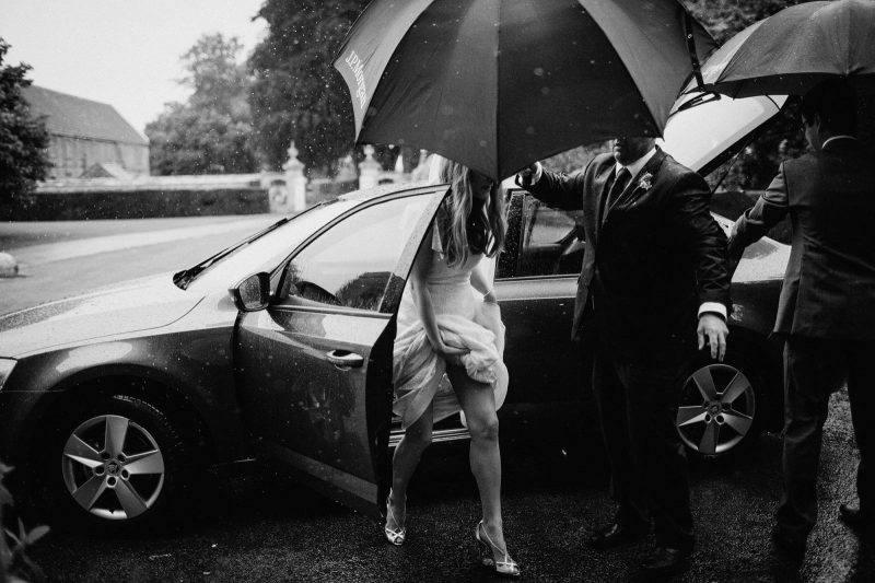 artisitc bride arriving in rain image by Claudia Rose Carter