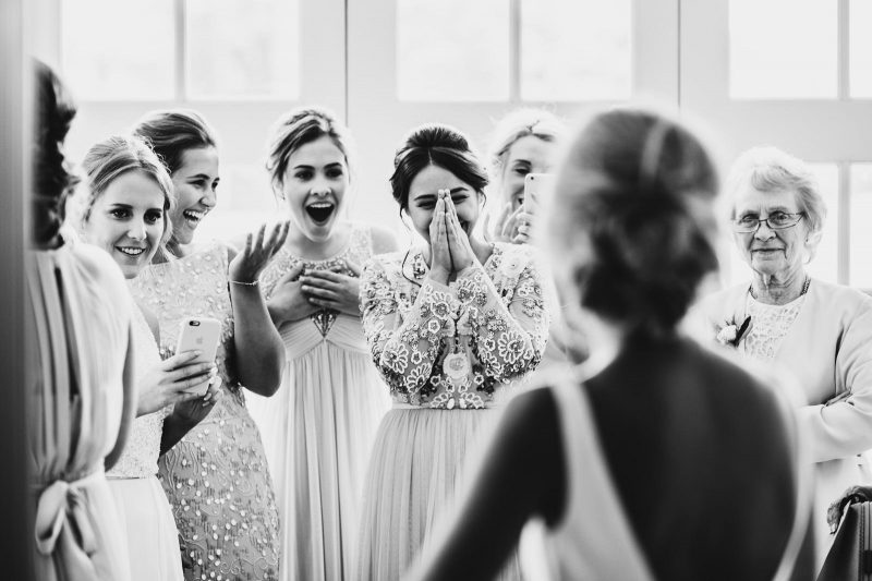 bridesmaids' reaction by Mark Wallis
